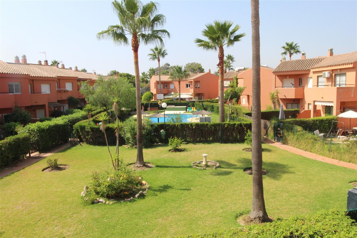 Manilva Beach: 3 bedroom 2 bathroom town house with private gardens to front and rear. Large living ,Spain