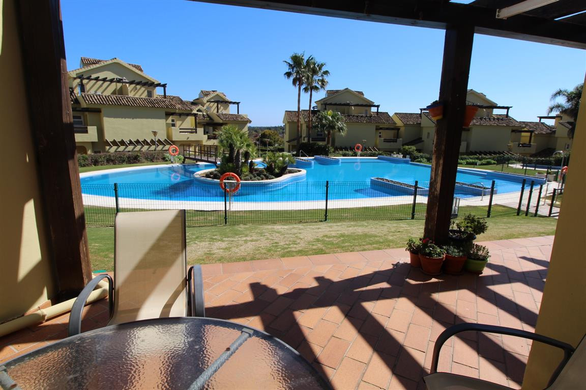 Hoya 1, Sotogrande: Good size garden apartment with views over pool to sea and private garden to the, Spain