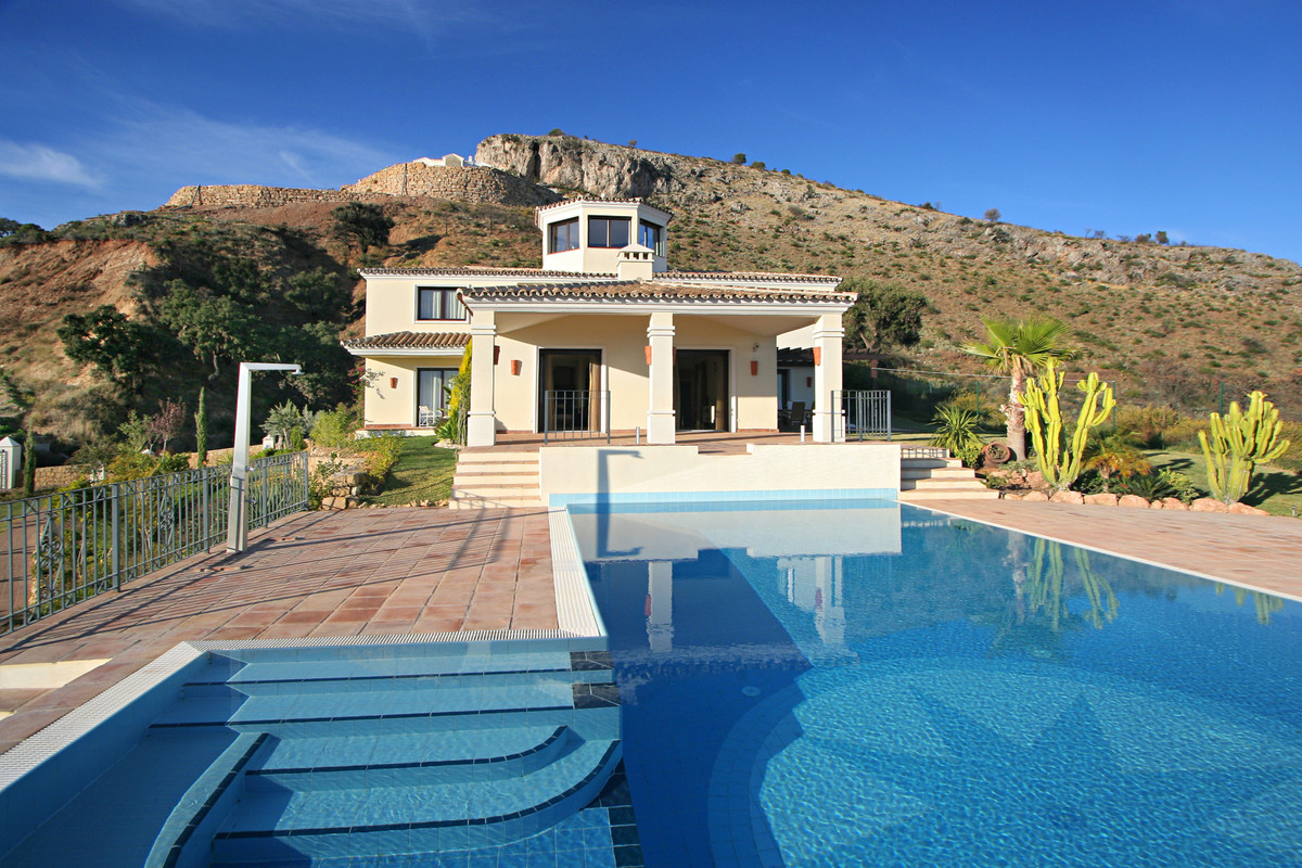 This South facing villa with a separate guest house in the hills of  the exclusive Marbella Club Gol,Spain