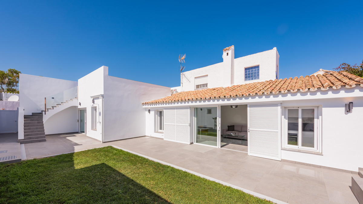 Two adjacent townhouses, situated in the hills above the eastern entrance of Estepona, which have be, Spain