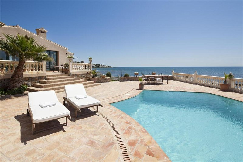 This frontline beach villa is located Calahonda, Mijas. It is completely fenced with 2 accesses to t,Spain