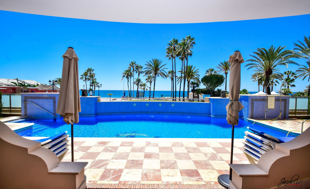 Magnificent ground floor apartment on first line of the beach in one of the most popular and beautif, Spain