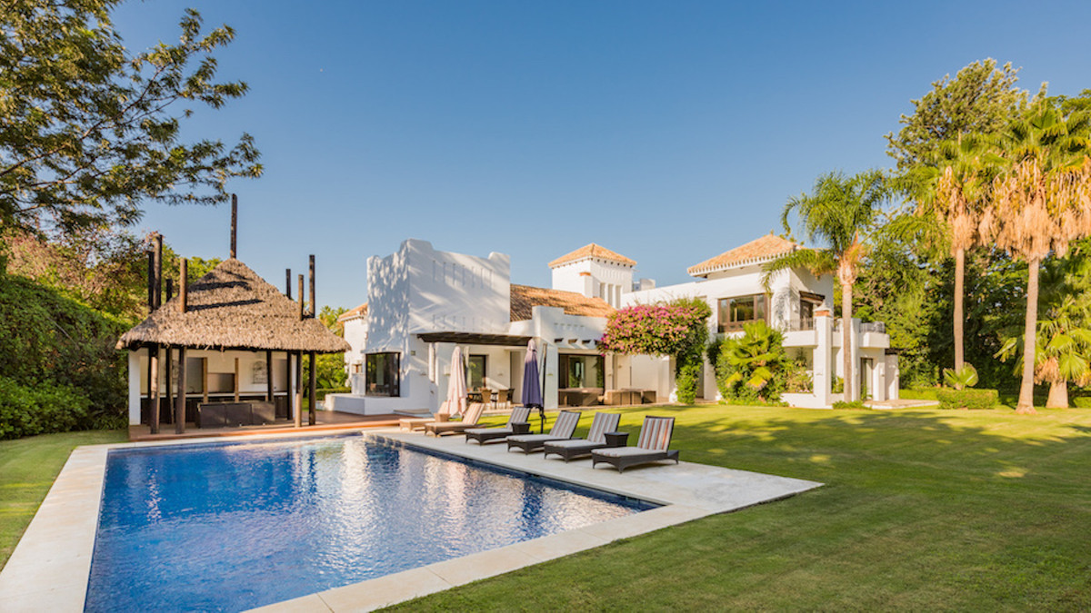 A luxury beachside villa in a top location close to Puerto Banus and Marbella. Guadalmina Baja is co, Spain