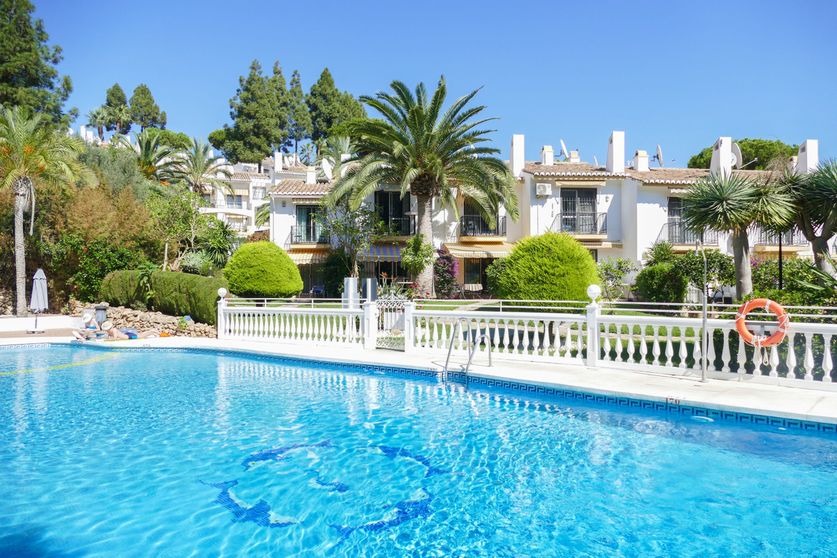 Pretty townhouse situated in a gated development in the heart of Calahonda. Tucked away from the mai,Spain