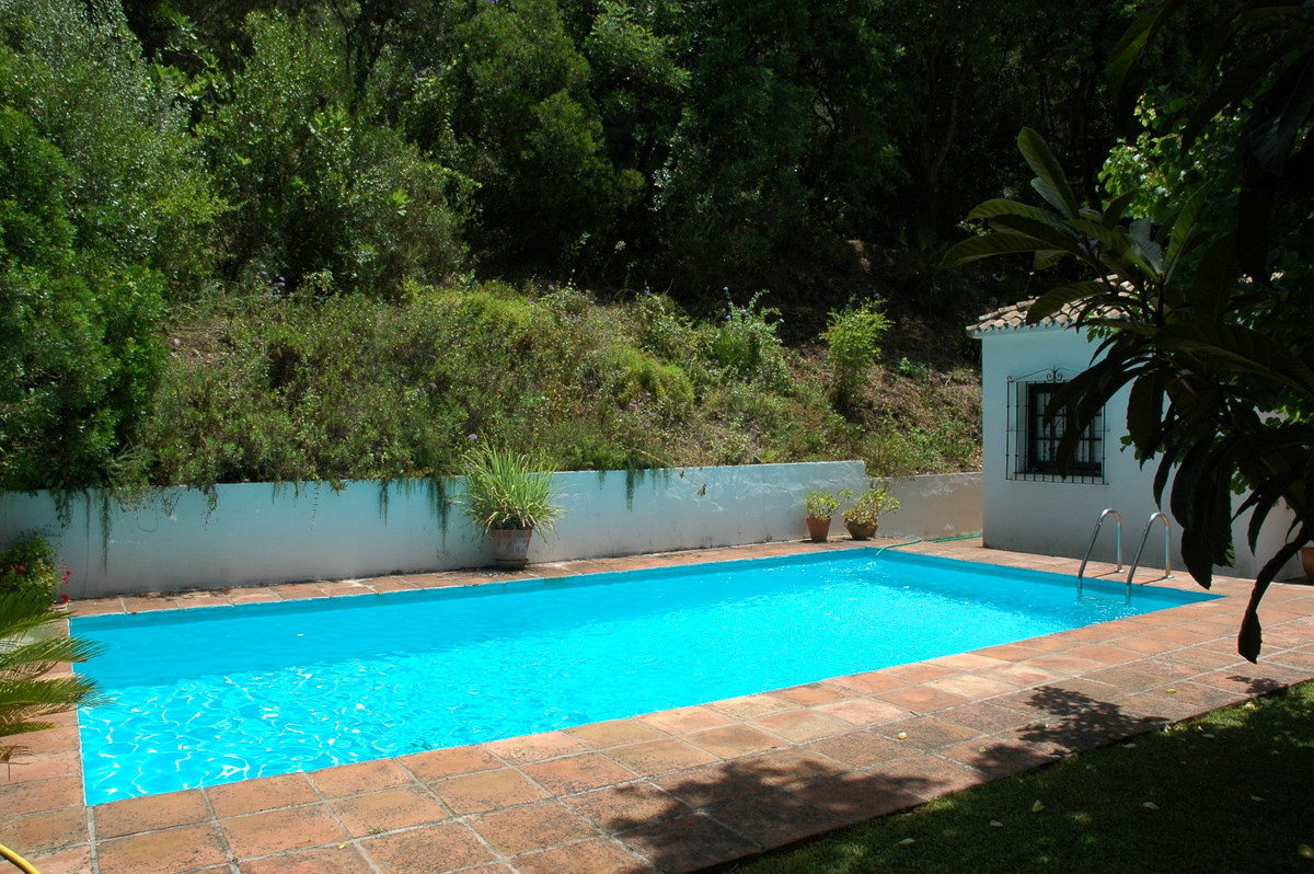 Ideally located in the sought-after village of Benahavis, only a ten-minute drive from the beach, th,Spain