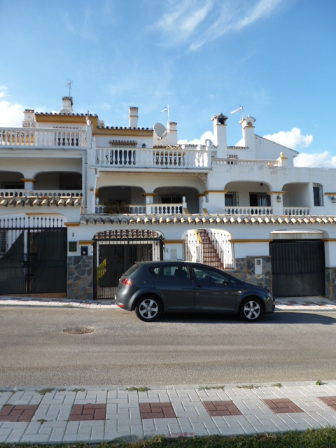A well located 4 bedroom property in the ever popular Torremuelle Urbanisation with its fantastic communal facilities which include tennis courts, padel tennis courts, extensive parkland and large swimming pool. There is also the advantage of a railway station making Malaga, the airport and Fuengirola easily accessible. The property benefits from a self contained 1 bedroom apartment with a full kitchen and refurbished shower room to the ground floor. On the first floor there is a good sized covered terrace/porch leading to the front entrance hallway benefiting from guest toilet and double entrance doors to the lounge/dining area. A half stairway leads to the good sized fitted kitchen and rear door to the courtyard. Up a further flight of stairs brings us to the 3 bedrooms and refurbished family bathroom and a further sun terrace with panoramic views. The property requires some updates which is reflected in the low price. Townhouse, Benalmadena Costa, Costa del Sol. 4 Bedrooms, 2.5 Bathrooms, Built 0 m². Setting : Close To Golf, Close To Sea, Urbanisation. Orientation : South. Condition : Good, Recently Refurbished. Pool : Communal, Children`s Pool. Climate Control : Fireplace. Views : Sea, Garden. Features : Covered Terrace, Fitted Wardrobes, Private Terrace, Satellite TV, Paddle Tennis, Tennis Court, Guest Apartment. Furniture : Not Furnished. Kitchen : Fully Fitted. Garden : Communal. Security : 24 Hour Security. Parking : Street. Utilities : Electricity, Drinkable Water, Telephone. Category : Bargain, Investment, Resale.