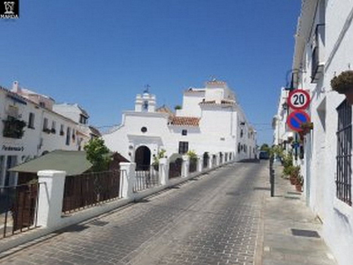 Typical town house in Mijas, Costa del Sol. The house has two entrances from two different streets. ,Spain