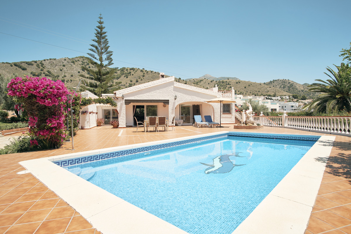 For sale we have this beautiful, private villa, set amongst mature gardens with its large heated poo,Spain