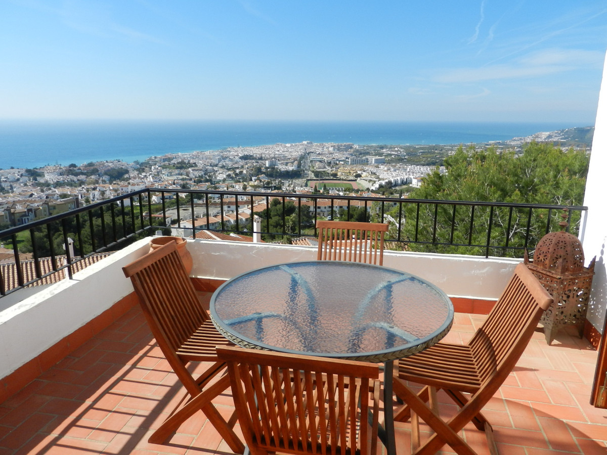 An excellently presented 2 bed, I bath apartment on Mandarinos Alto with east to west sea views over, Spain