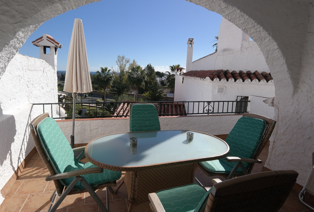 A delightful modern 1 bedroom townhouse, with two private terraces and private small garden in a sec, Spain