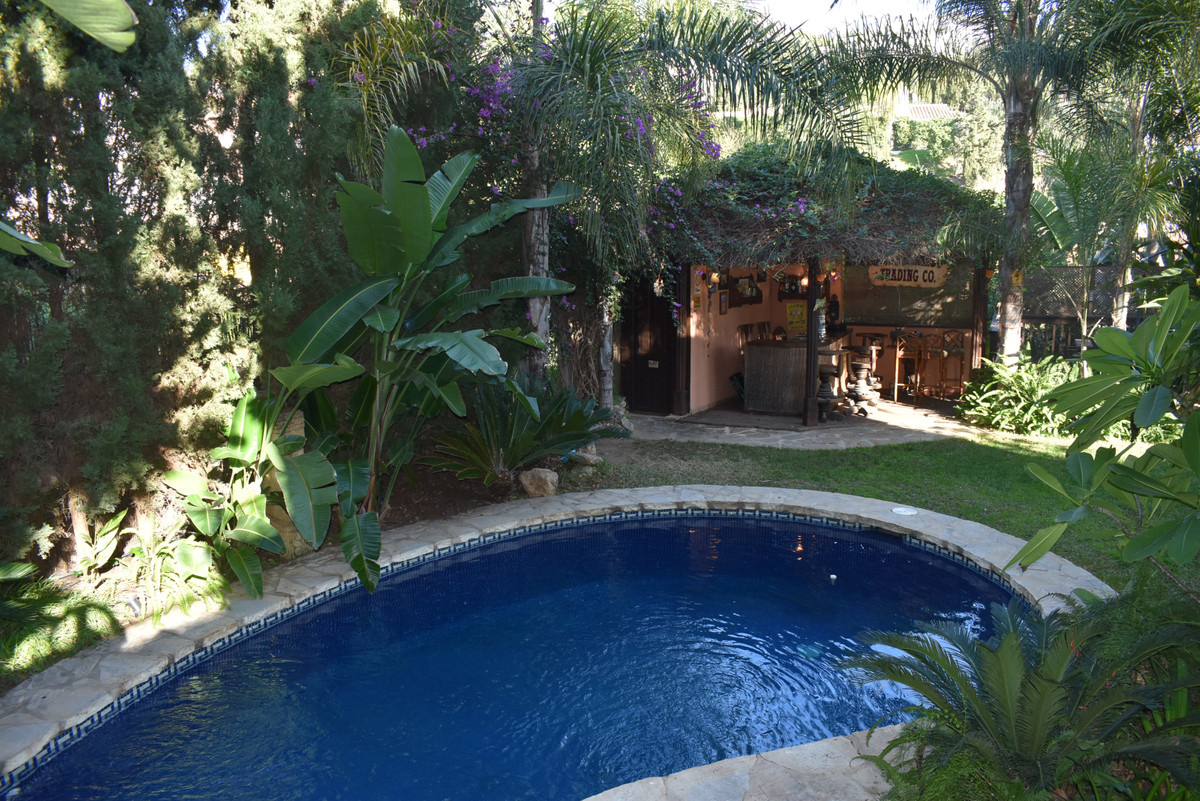 A TROPICAL PARADISE! A well appointed villa set amidst superb gardens reminiscent of the sub tropica, Spain