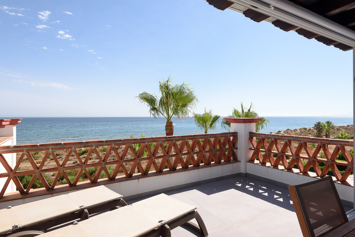 Beachfront house for sale in Marbella. This South facing corner townhouse is located in Las Dunas, a,Spain