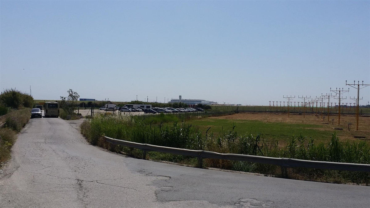 A rustic plot of land right next to Malaga Airport.  Ideal for car rental or airport car park busine, Spain