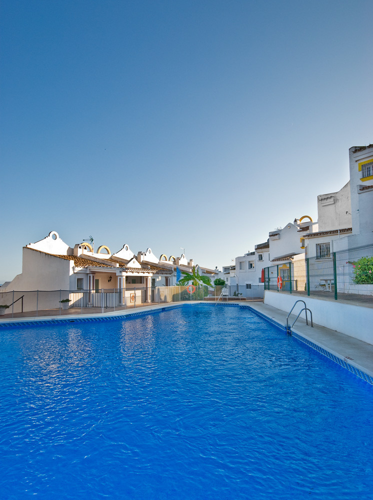 Attractively decorated south facing townhouse with ample living space and scope to extend to the fro, Spain