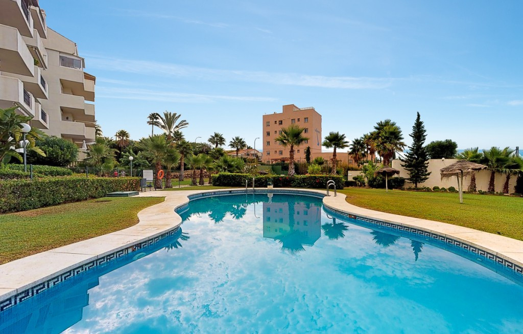 Fabulous 2 bedroom apartment located in a private and very quiet urbanization just a few meters from,Spain
