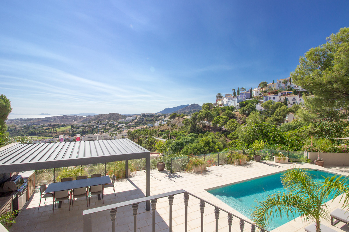 A stunning and spacious four bedroom town house with breath-taking views..   On the principal living,Spain
