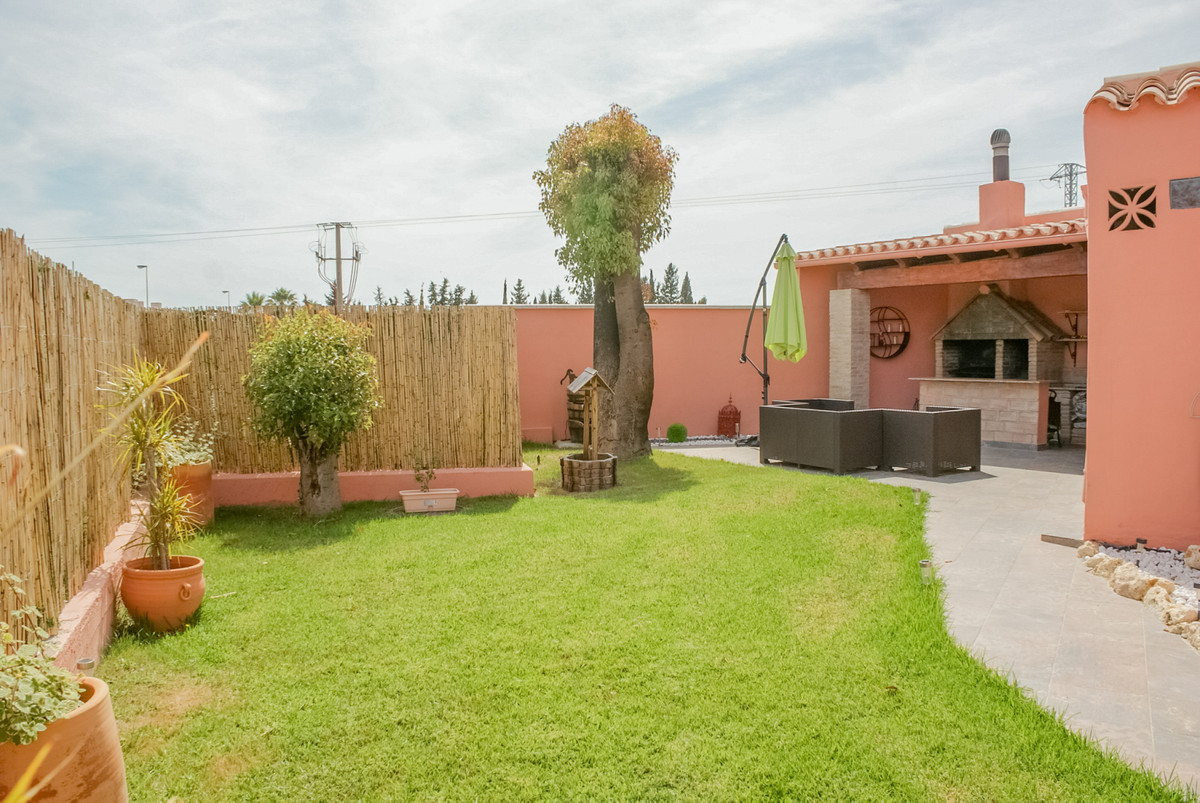 Townhouse with private garden is located in a development of only 24 homes, just a few metres from t,Spain