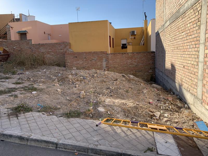 Участок в городе - Coín - homeandhelp.com