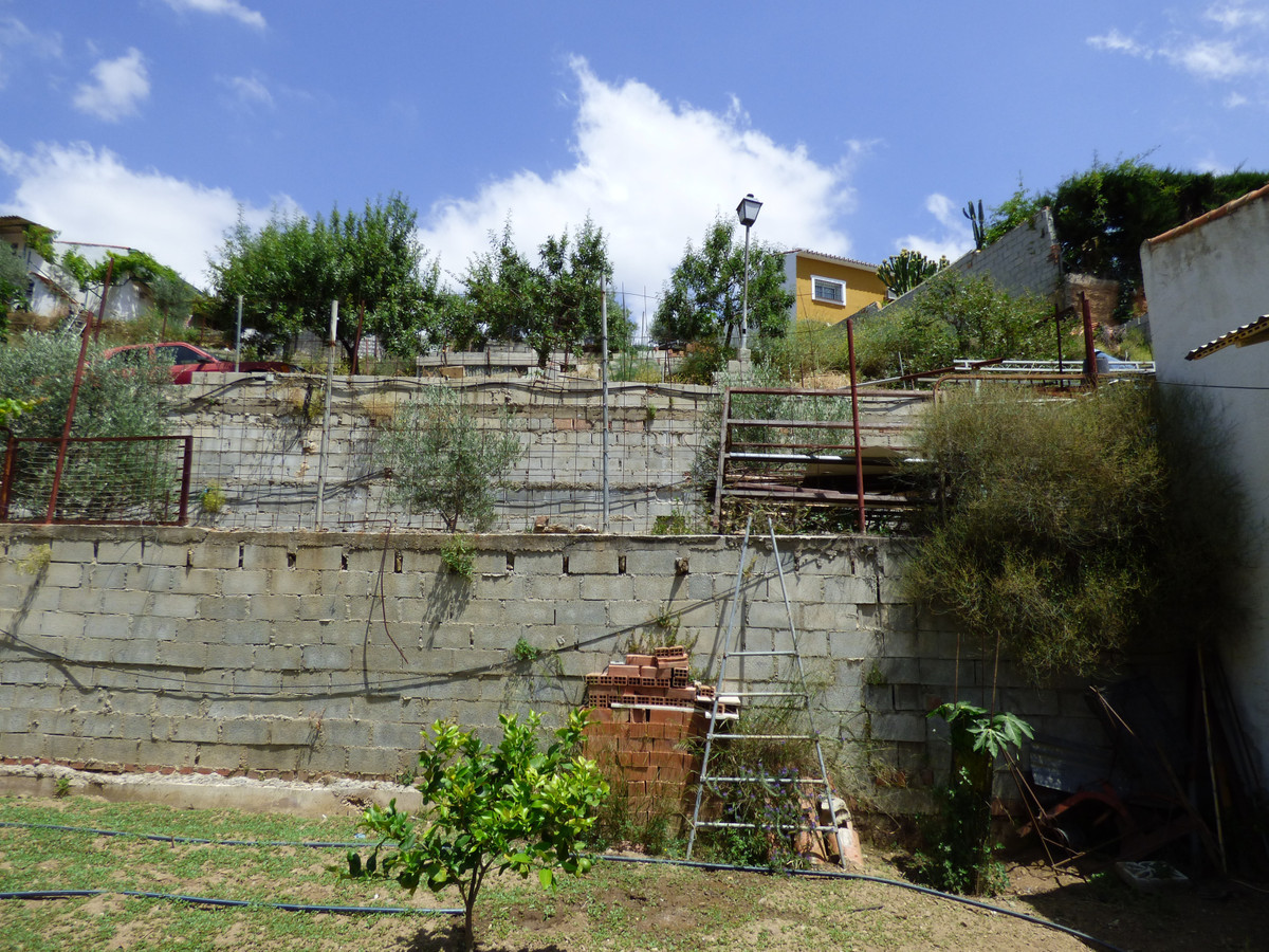PLOT IN EL HORNILLO WITH BUILT HOUSING, GARDENS, FRUIT TREES, STORAGE AND MORE CONSTRUCTIONS,Spain