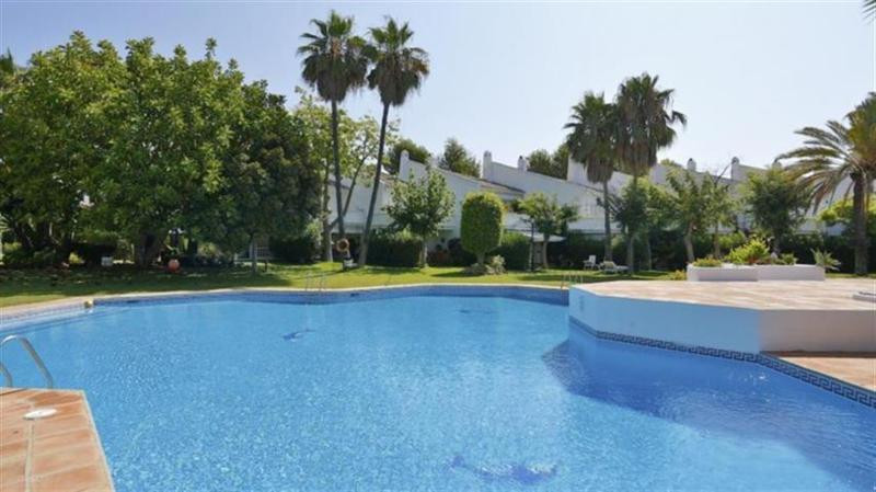 RENTED Charming townhouse set in a small gated complex of only 36 houses sharing a large garden and , Spain