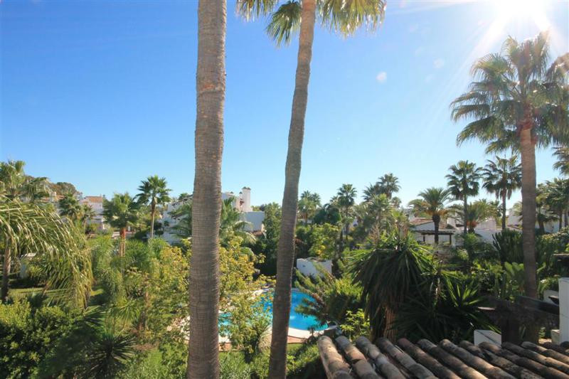 This lovely townhouse is set within an exclusive, secure beach side development of townhouses with e, Spain