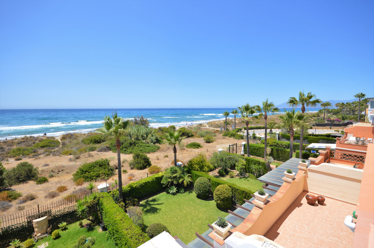 Front line beach townhouse in Bahia Marbella with frontal sea view, Marbella. The property is locate,Spain