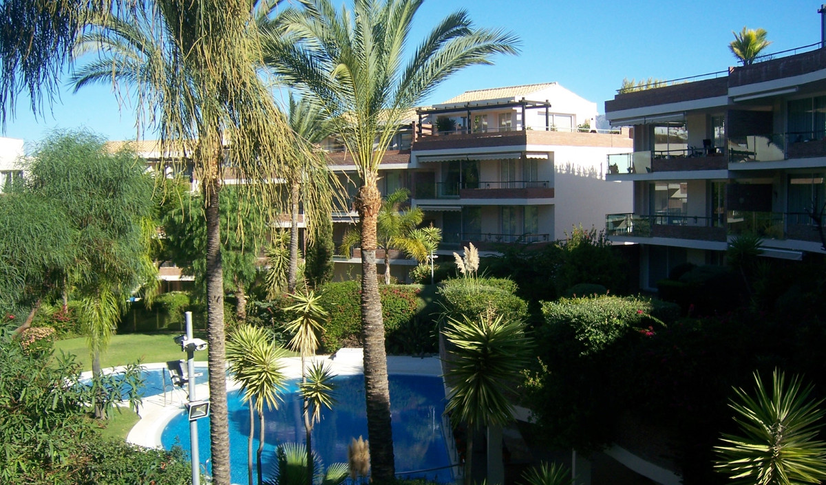 South facing garden apartment located in the acclaimed gated complex of Milenio in Miraflores. The p, Spain