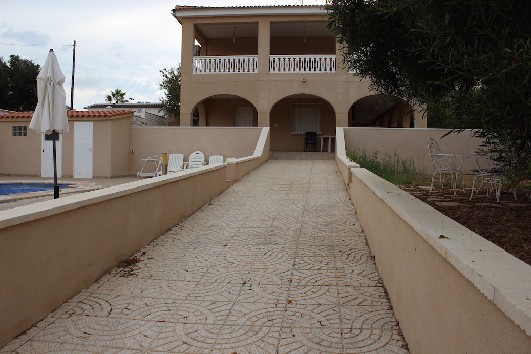 Villa with private pool and garden with a green seating area. The house consists of two floors, eac,Spain