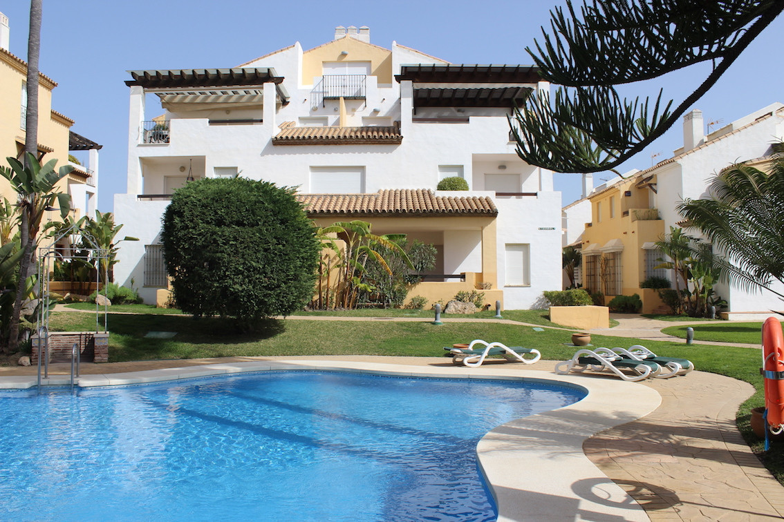 Wonderful 4 bedroom first line beach townhouse in Las Arenas, famous complex located within Urbanisa,Spain