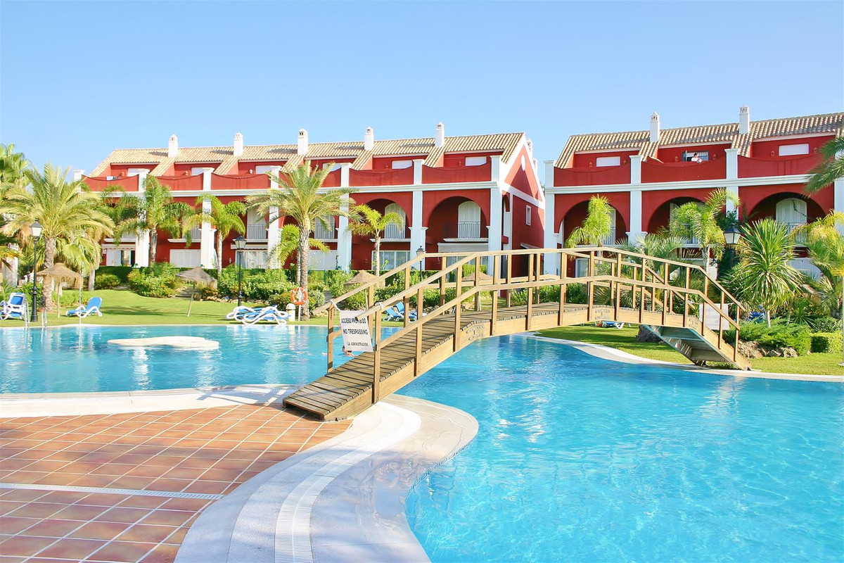 A superb south facing townhouse with sea views located in a private residential beachside complex wi,Spain