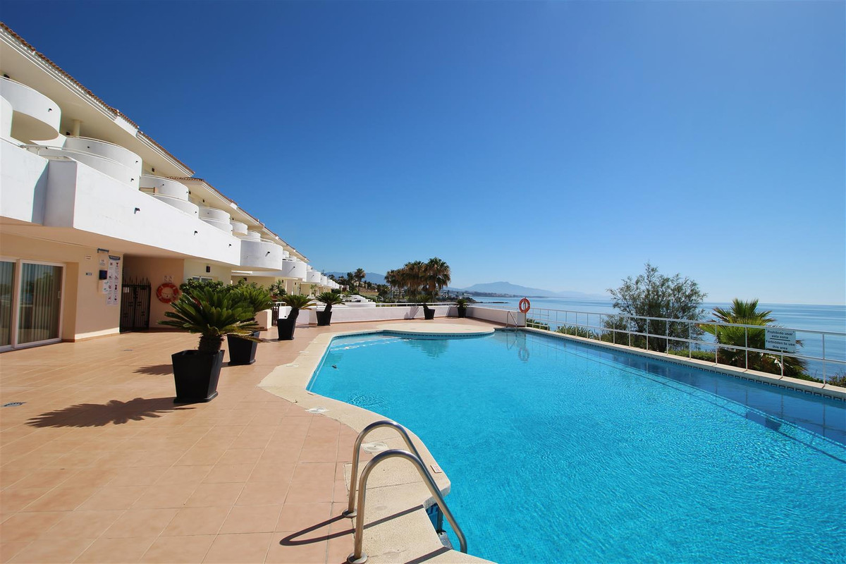 Stunning FRONTLINE BEACH duplex penthouse for sale in Estepona. Located in a residential complex con, Spain