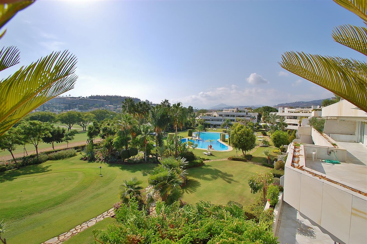 This extraordinary duplex penthouse is situated in an exclusive urbanisation overlooking the golf co, Spain
