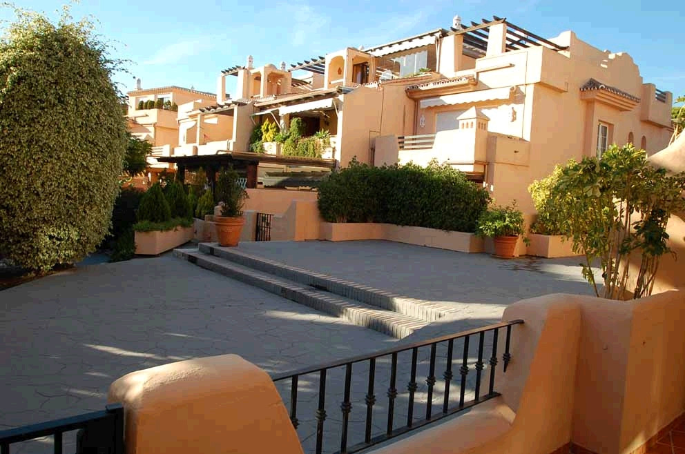 This luxurious west facing townhouse is located in an enclosed residential complex offering 12 hour , Spain