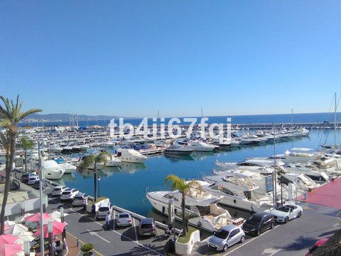 Lovely 4 bedroom duplex apartment in Puerto Banus. Panoramic views, private teracce.  At the heart o,Spain