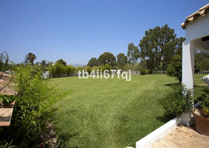 Beautiful villa with total privacy located frontline golf . This amazing property has 2 covered terr, Spain