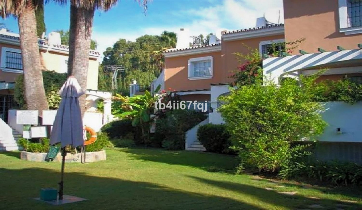 Townhouse in Nueva Andalucia. This fabulous south facing five-bedroom townhouse is located in the he, Spain