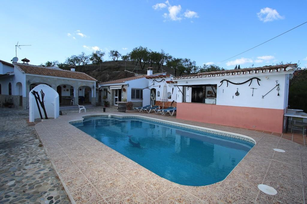 Large country property in the peaceful hills of Guaro.   This extensive property would be ideal for ,Spain