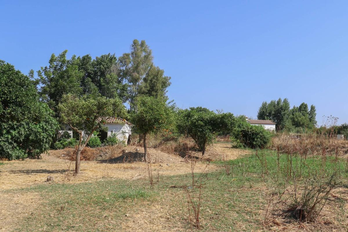Plot of land sloping down to the river.   A ruin sits on the plot, in need of restoration.  The loca, Spain