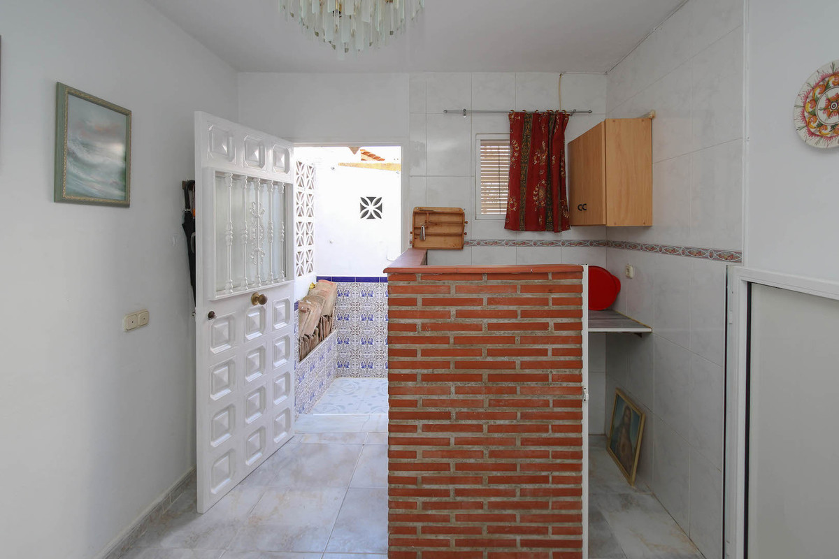 Garage  .   with ktichenette and bathroom .   Bustling town .   Close to many TAPAS Bars   Located a, Spain
