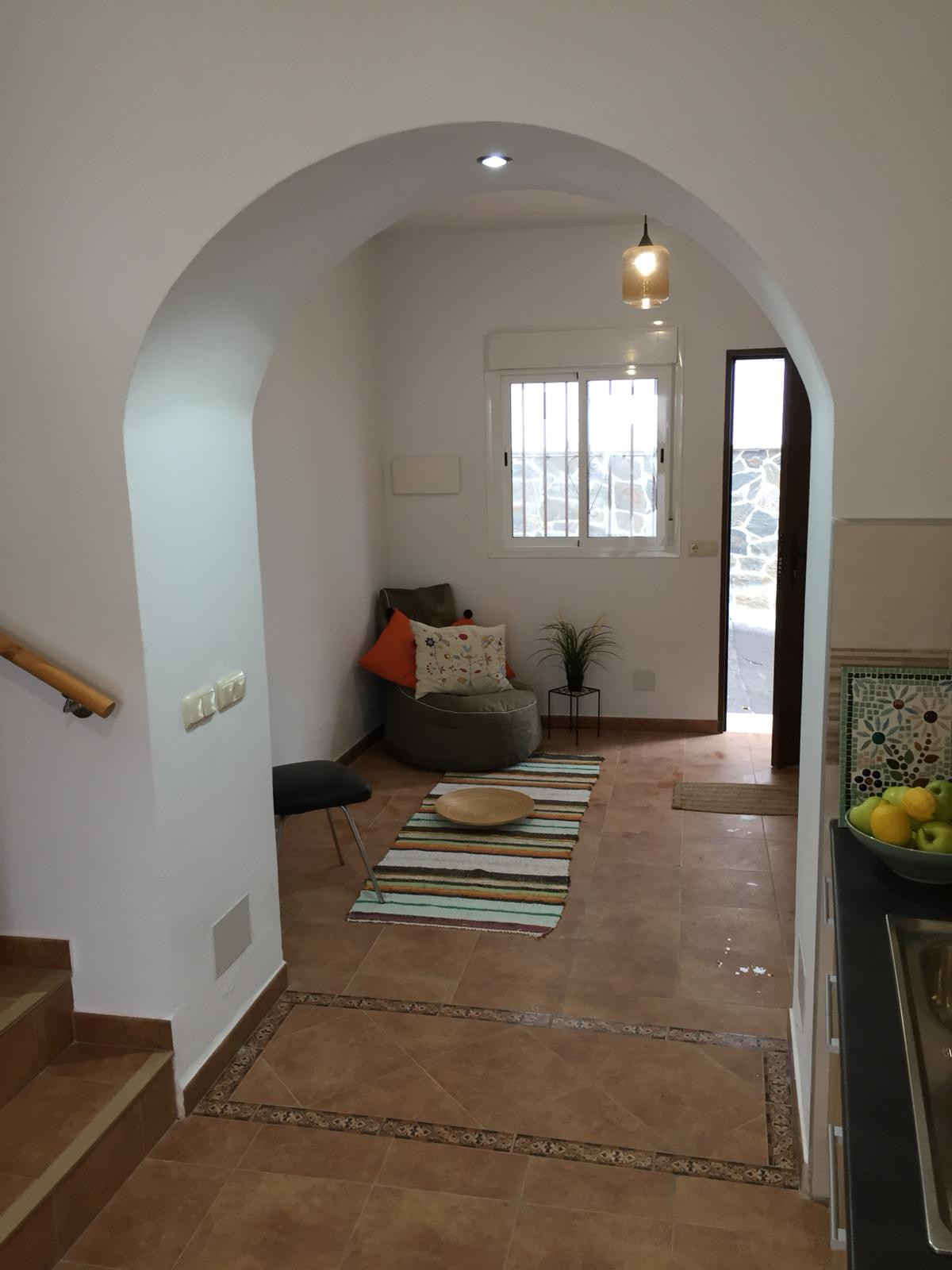 Beautifully reformed townhouse in the centre of Guaro.   This authentic townhouse is spread over 3-l,Spain