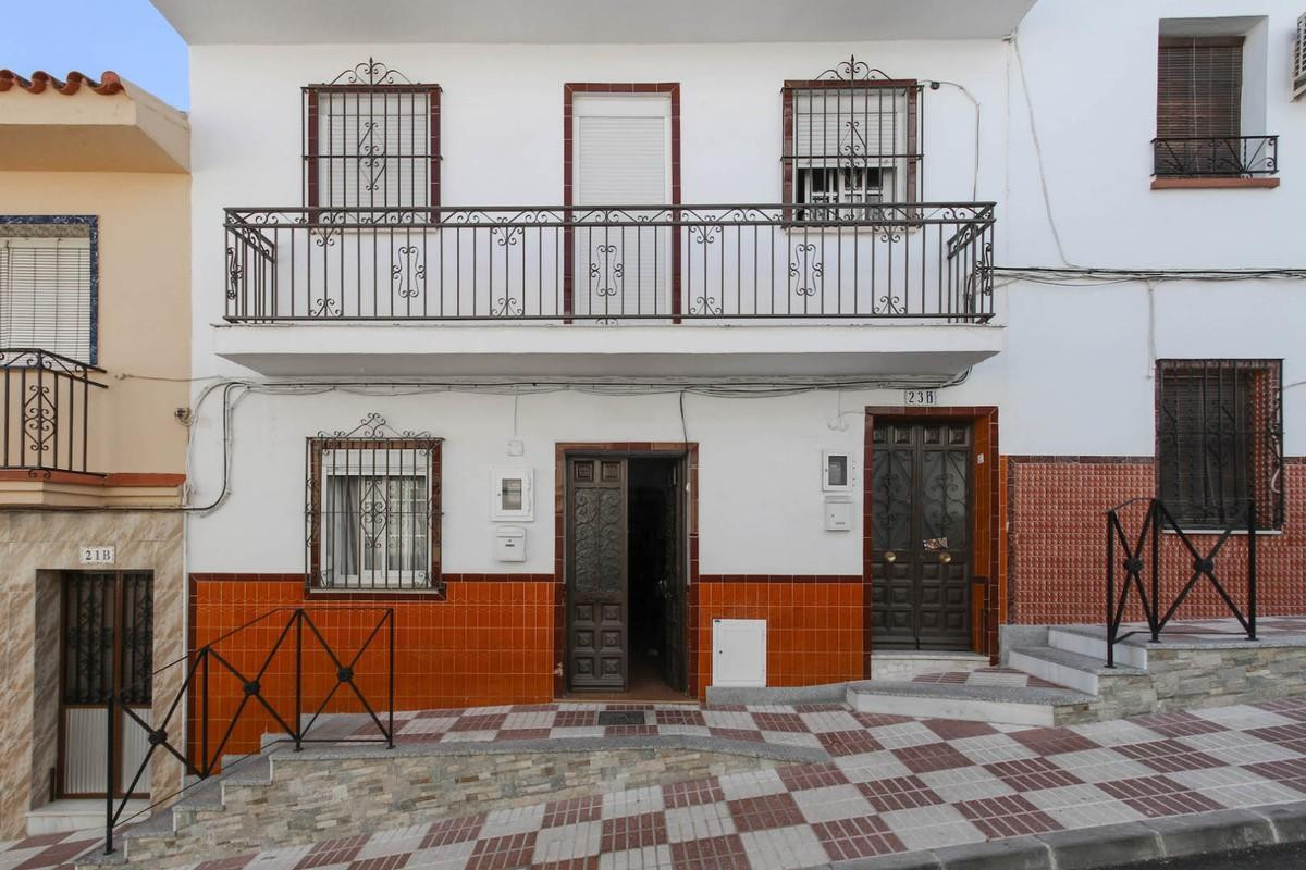 In the heart of a busy Andalucian town sits this two storey townhouse in Alhaurin el Grande.   Situa, Spain