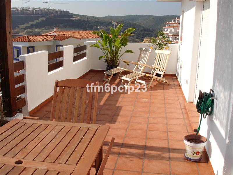 Excellent value 1st floor apartment in this pretty Andalucian style urbanization situated on the pop, Spain