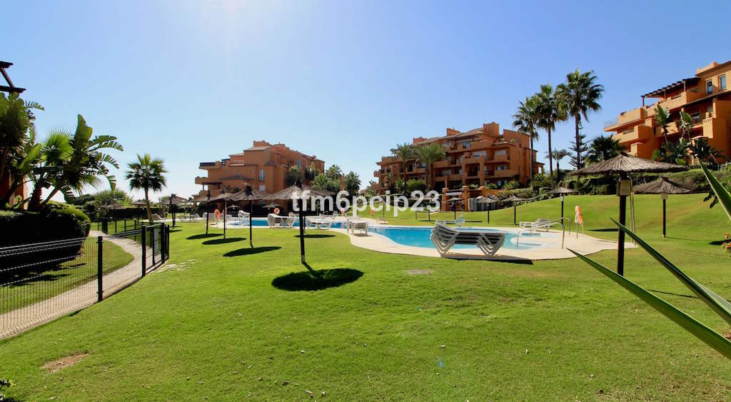 This beautiful LUXURY BEACH FRONT 3 bedroom, 2 bathroom, ground floor apartment is situated in on on, Spain