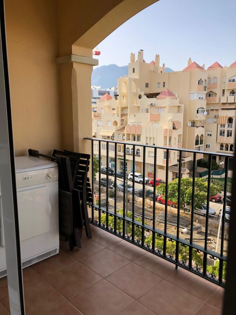 Lägenhet på mellanplan in Estepona
