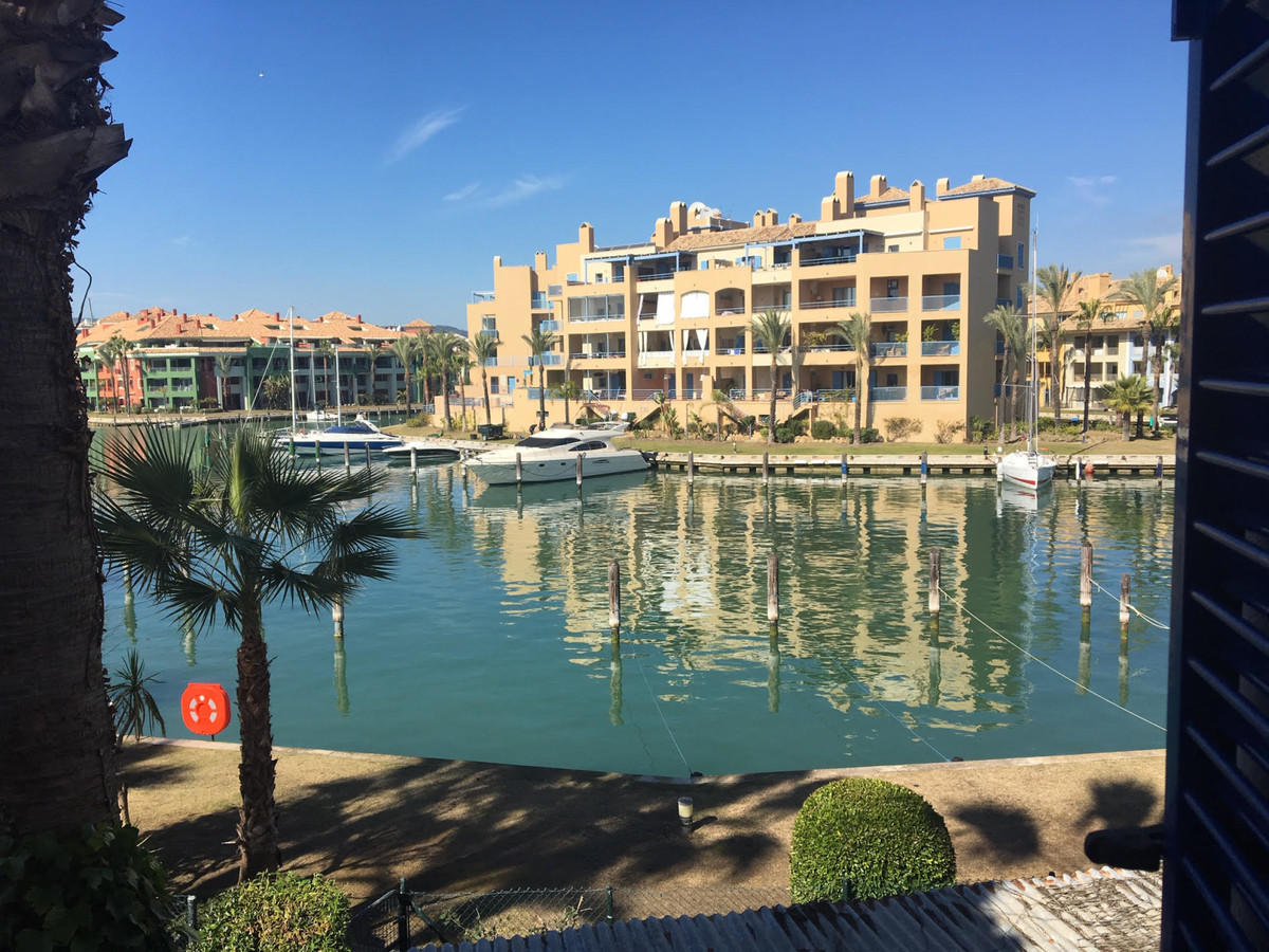 Great townhouse in La Marina de Sotogrande with views to the Marina in front and behind the gardens., Spain