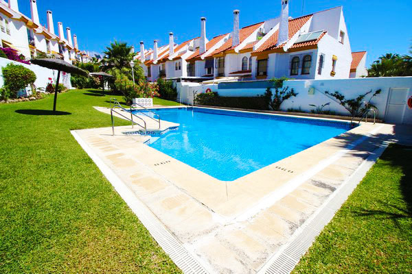 A Semi-Detached townhouse located a short distance from the Port of Estepona.The property benefits f,Spain