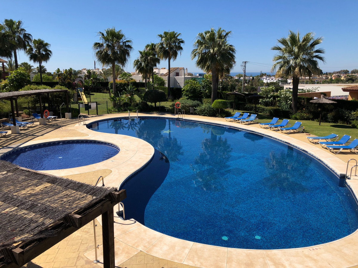 A lovely, spacious 3 bed, 2 bath ground floor apartment with private garden in the popular and very , Spain