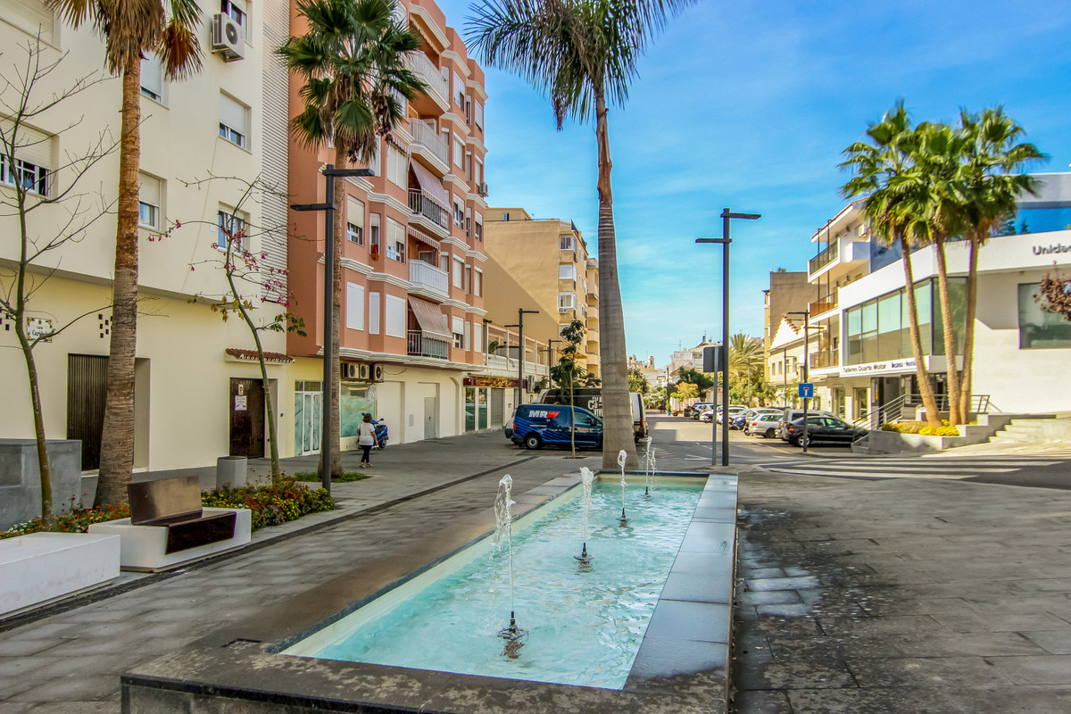 Estepona is located in southern Costa del Sol. The promenade is full of palm trees and runs along th,Spain