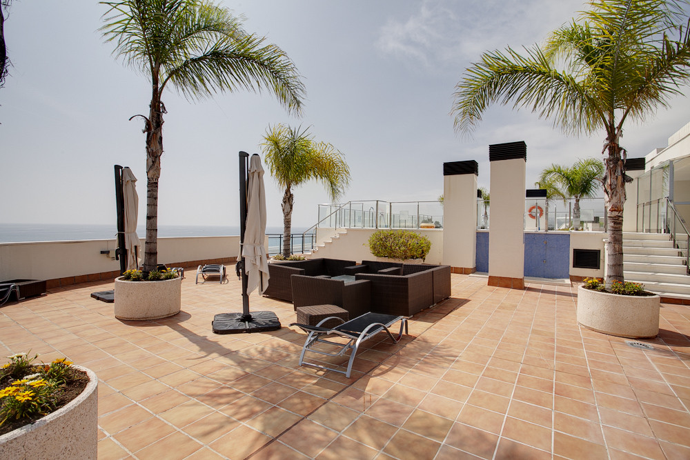 Modern beachfront apartment with good sea views west orientation for afternoon sun. The development ,Spain