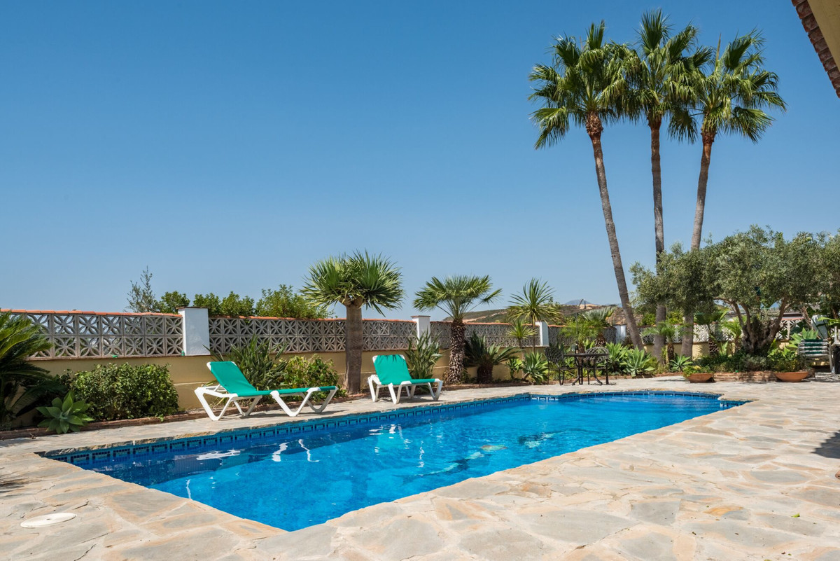 Lovely family home in a rustic style with sea views. The large garden boasts entertaining area for b,Spain